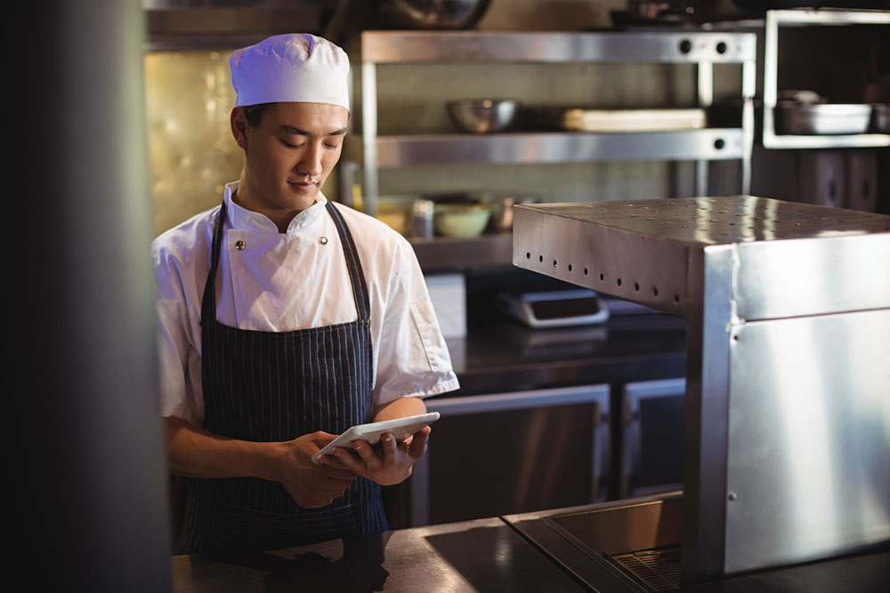 Millenial Chef with tablet