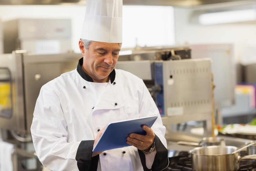 Chef using his digital tablet in the kitchen-1